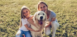 Dog with mother and daughter